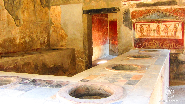 Pompeii, Thermopolium, Thermopolium Vetutius Placius, Via dell'Abbondanza, Herculaneum, archaeology, Mount Vesuvius, Roman art, eruption, 79 ad, Amalfi coast, Sorrento, Italian art, Pompeii ruins, Pompeii tours, guided tours Pompeii, volcano, Naples, Igor Mitoraj